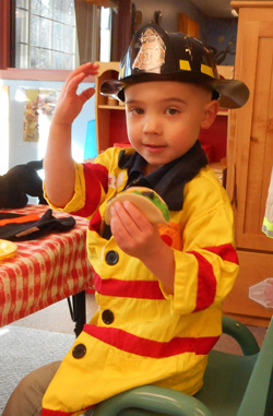Boy in fire hat