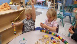 Kids Stringing Beads
