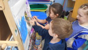 Kids at Paint Easel